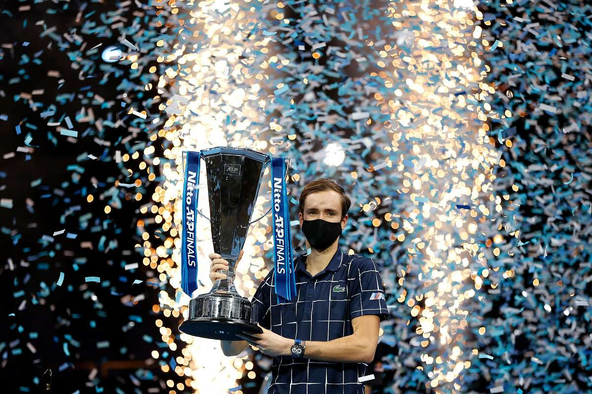 LONDON, ENGLAND - NOVEMBER 22: Daniil Medvedev of Russia lifts the trophy after winning his singles final match against Dominic Thiem of Austria during day eight of the Nitto ATP World Tour Finals at The O2 Arena on November 22, 2020 in London, England. (Photo by Clive Brunskill/Getty Images)