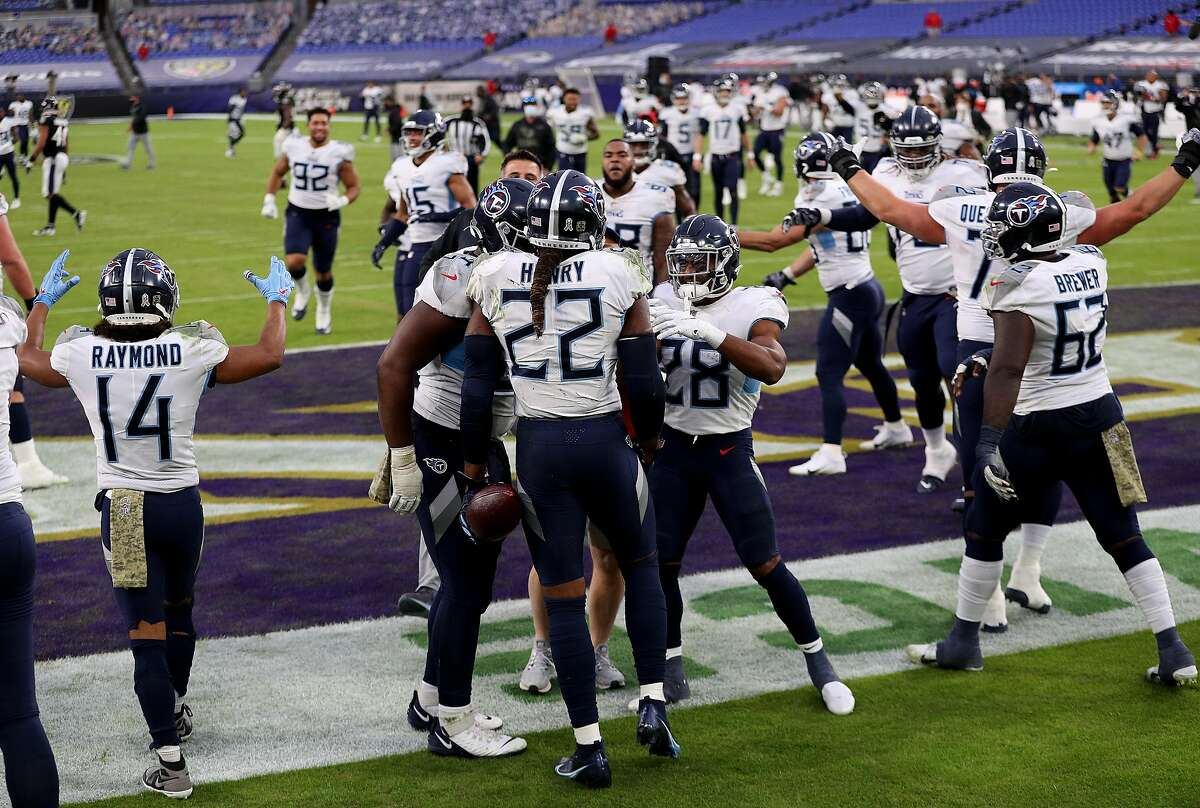 Titans running back Derrick Henry (22) celebrates after the game-winning touchdown in overtime over Ravens.