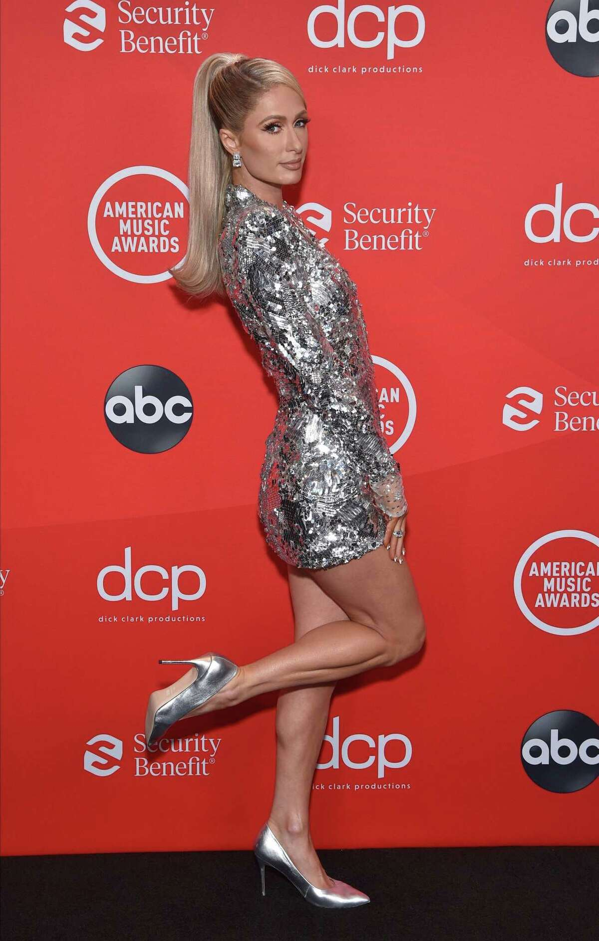 In this handout image courtesy of ABC socialite Paris Hilton poses during the 2020 American Music Awards aired from the Microsoft theatre on November 22, 2020 in Los Angeles. (Photo by - / American Broadcasting Companies, Inc. / ABC / AFP) / RESTRICTED TO EDITORIAL USE - MANDATORY CREDIT