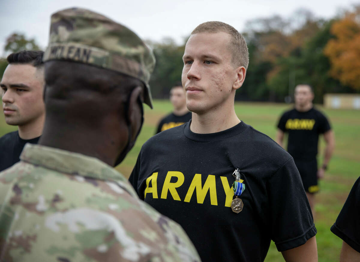 New York Army National Guard Spc. Alex Fish, receives an Army Achievement Medal from Command Sgt. Major Anthony McLean at Camp Smith Training Site, Peekskill. (Staff Sgt. Jonathan Pietrantoni / . Army National Guard)