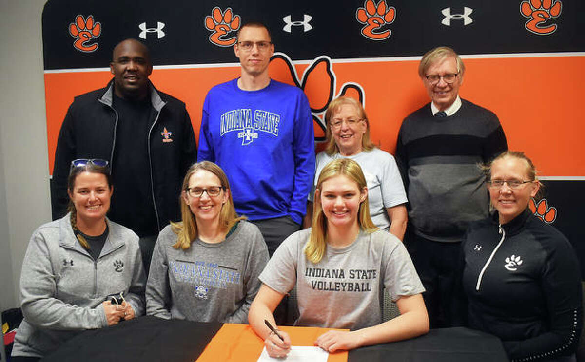 Edwardsville High School senior Storm Suhre, seated second from right, will play college volleyball at Indiana State. She is joined by her family, including her grandparents, club coach, EHS coach Heather Ohlau and EHS assistant coach Camilla Eberlin.