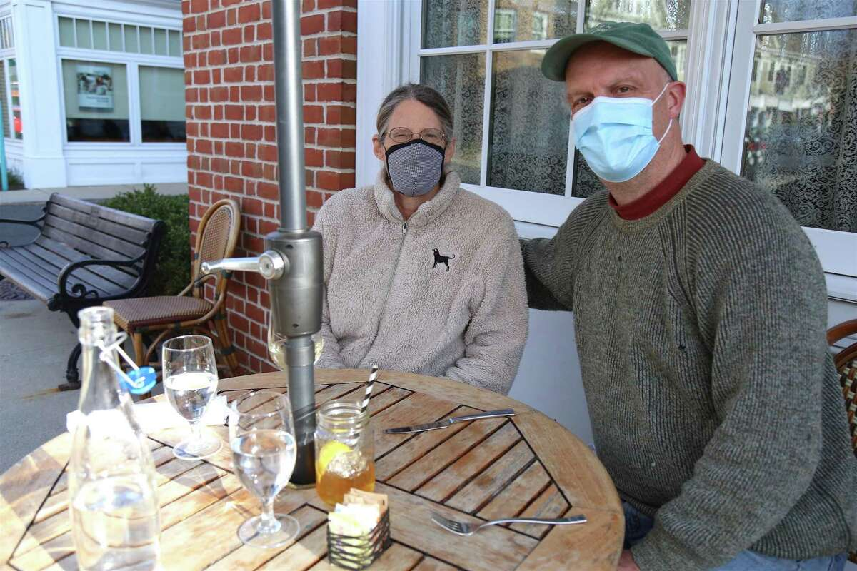 Janet Adams and Richard Hollyday of Norwalk, dining at Ten Twenty Post, always eat outdoors these days, owing to Adams' health issues, but they've been very pleased with how the restaurants have responded.