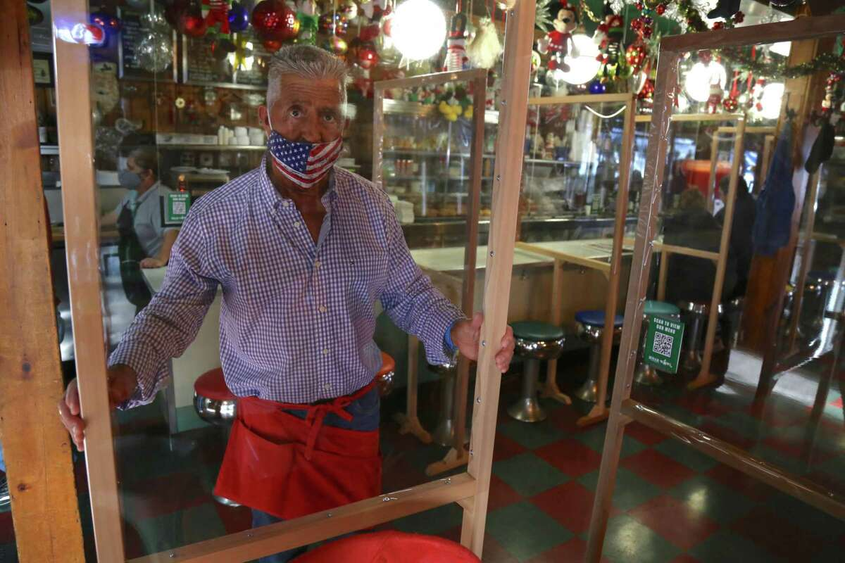 Bob Mazza, owner of the Sugar Bowl Luncheonette, installed partitions in November.