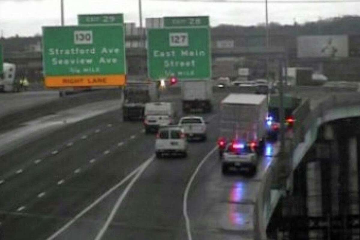 Emergency responders remained on scene on the shoulder of I-95 in Bridgeport, Conn., on Monday, Nov. 23, 2020, after a tractor-trailer jackknifed, blocking several lanes and spilling fuel on the roadway.