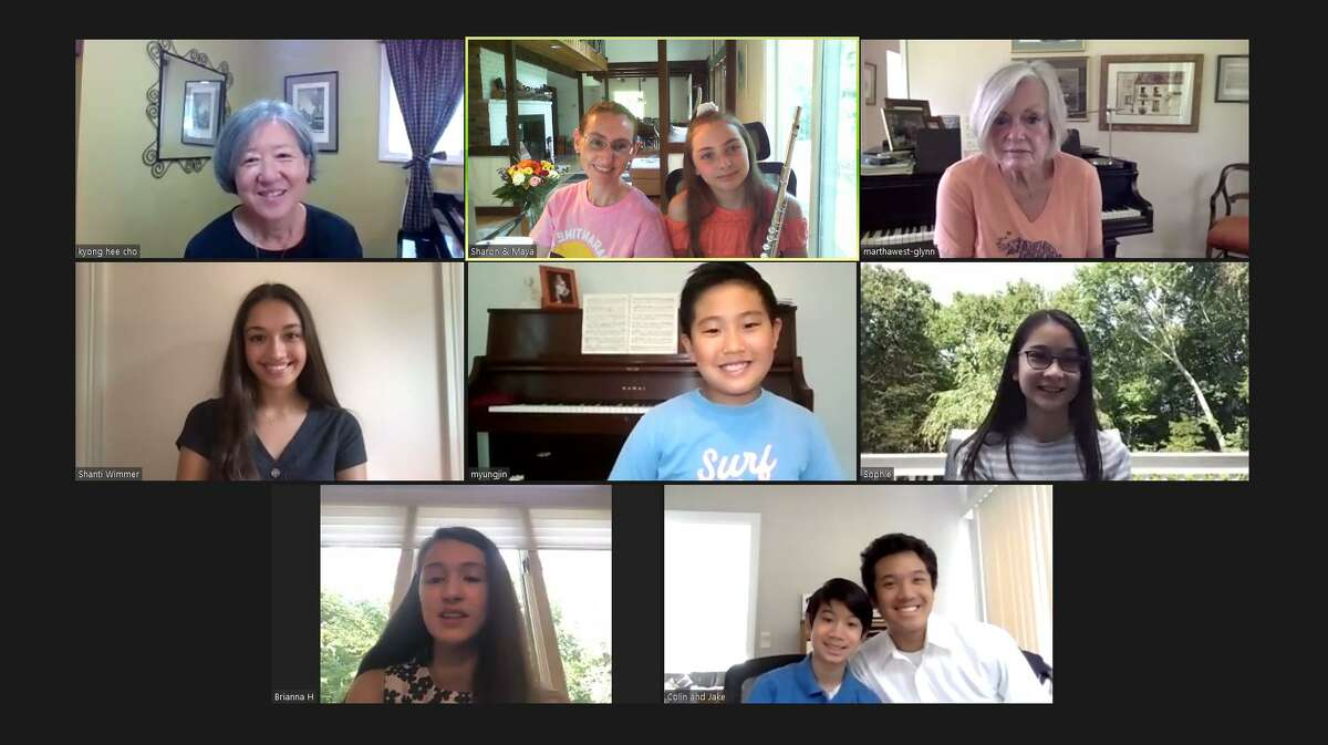 Wilton piano teacher Kyong Hee Cho, upper left, meets virtually with her students who will perform in a benefit concert on Nov. 29.