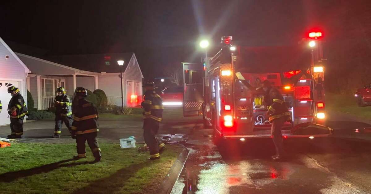 Fire units on scene for a fire at a condo unit in Monroe, Conn., on Saturday, Nov. 21, 2020.