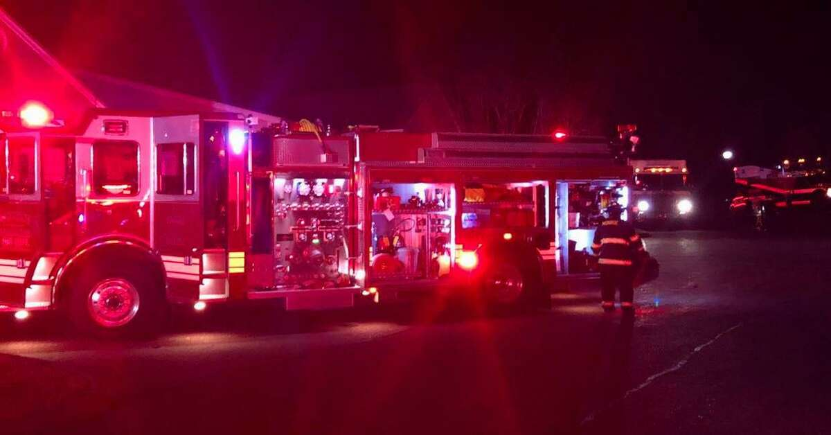 Fire units on scene for a fire at a condo unit in Monroe, Conn., on Saturday, Nov. 21, 2020.