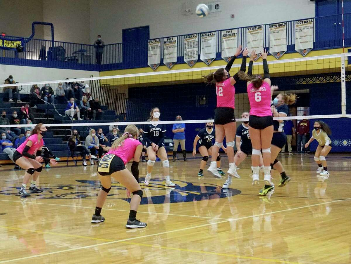 Morley Stanwood seniors Brooke Brauher and Landrie LaPreze go virtual to block a ball during a match against Lakeview earlier this season. (Pioneer file photo)