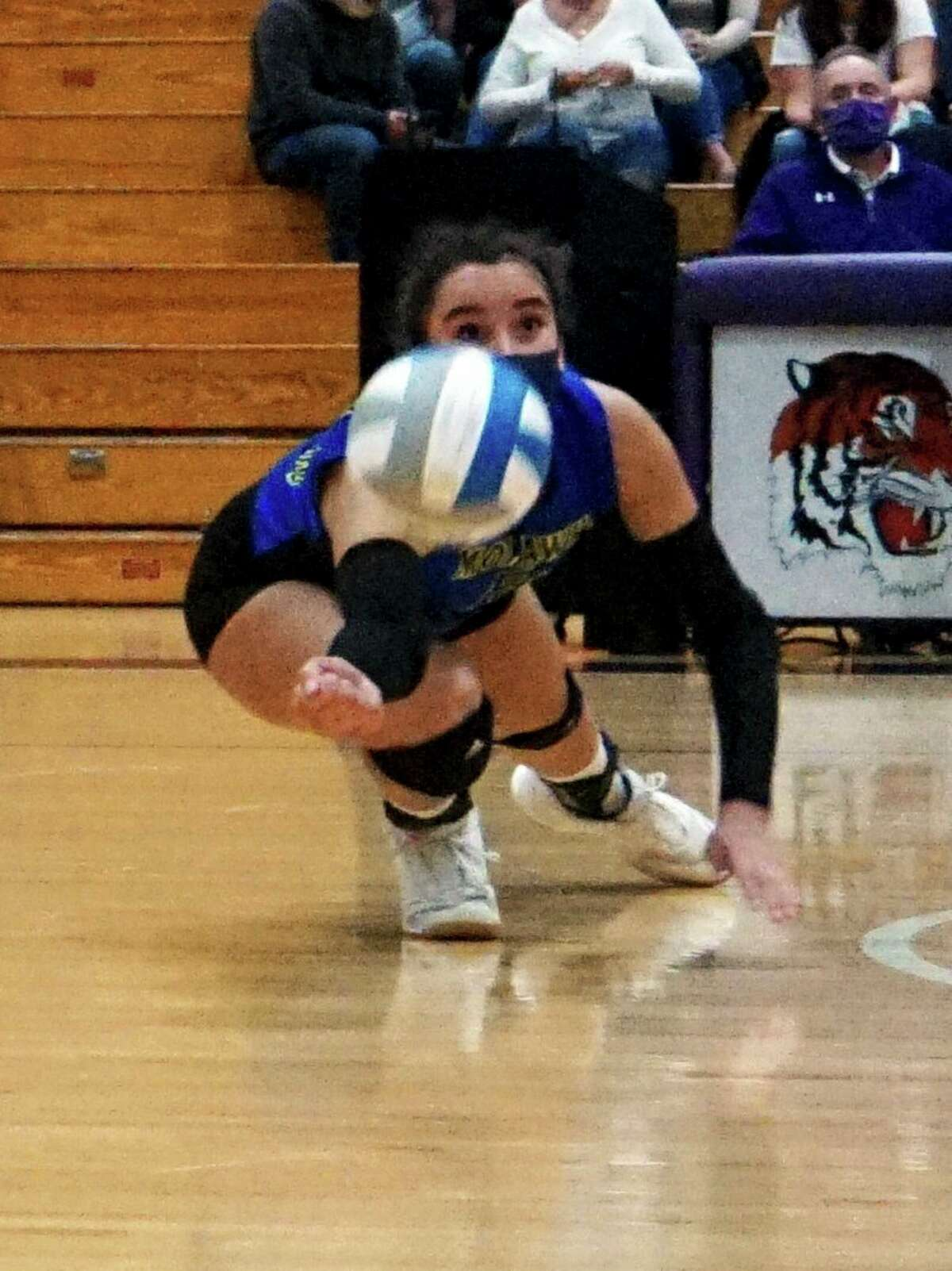 Junior Braelyn Berry, of Morley Stanwood, reaches low to get a ball during a match this season. (Pioneer file photo)