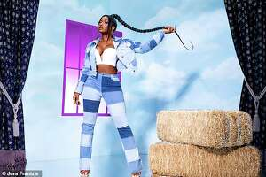 Megan Thee Stallion poses for her new line with Fashion Nova.