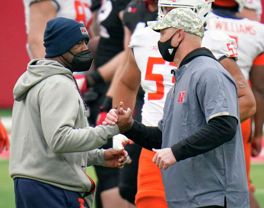 Illinois coach Lovie Smith (left) and Nebraska coach Scott Frost meet at midfield after the Illini's 41-23 Big Ten Conference victory Saturday in Lincoln, Neb. Photo: Associated Press