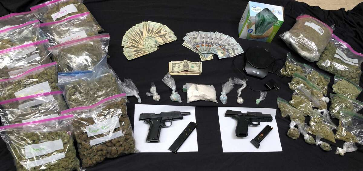 Sheriff deputies say they recovered these two guns and various drugs from a Green Island man's home on Saturday.