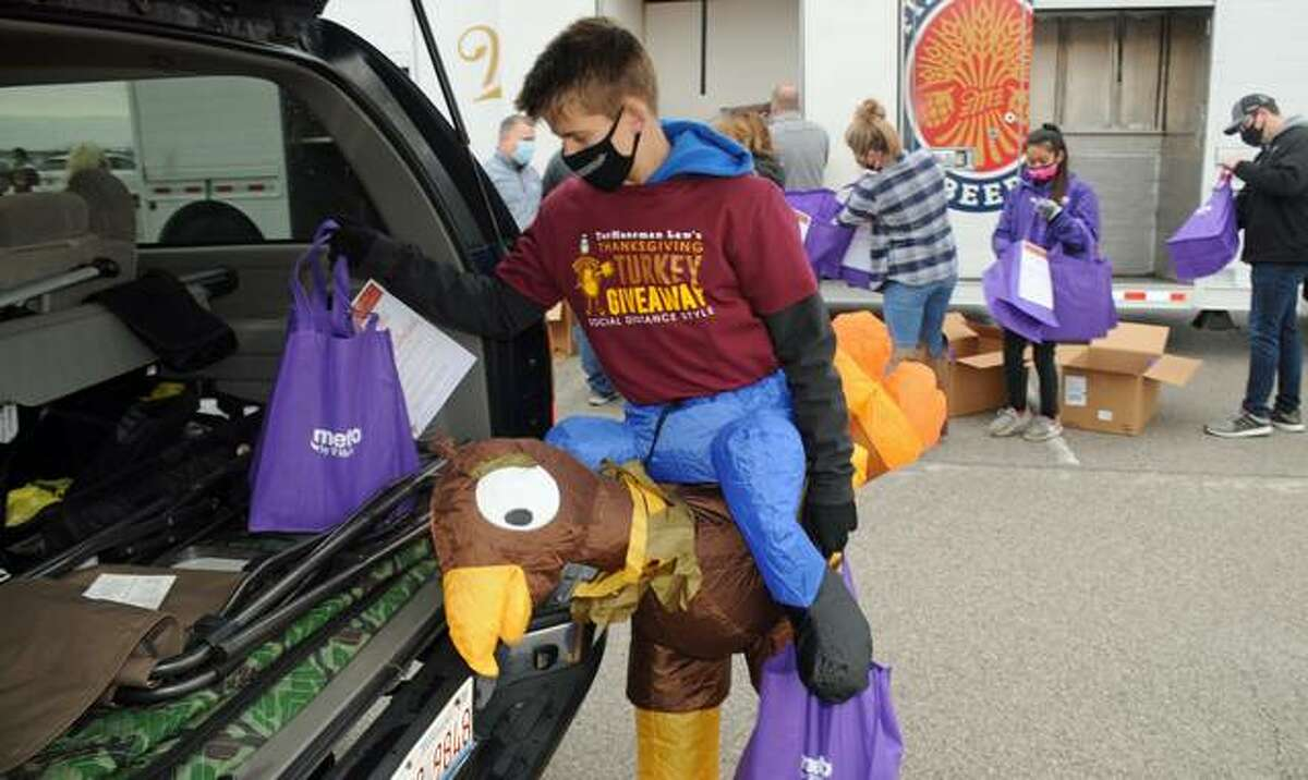Andrew Roth, the son of a TorHoerman Law employee, donned festive attire as he helped to load free turkeys into waiting vehicles on Saturday. The firm gave away 600 turkeys on Saturday, the seventh year it has helped provide area families with Thanksgiving dinners.