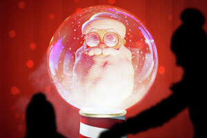 The innovative holiday installation features a three-dimensional Santa Claus inside a giant snow globe.