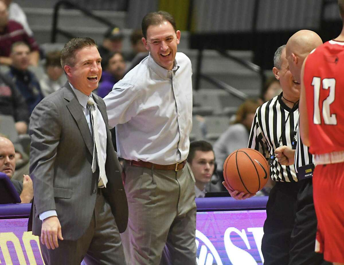Hartford head coach John Gallagher, left, jokes with University at Albany head coach Will Brown before a basketball game at SEFCU Arena on Wednesday, Jan. 3, 2018 in Albany, N.Y. (Lori Van Buren / Times Union)