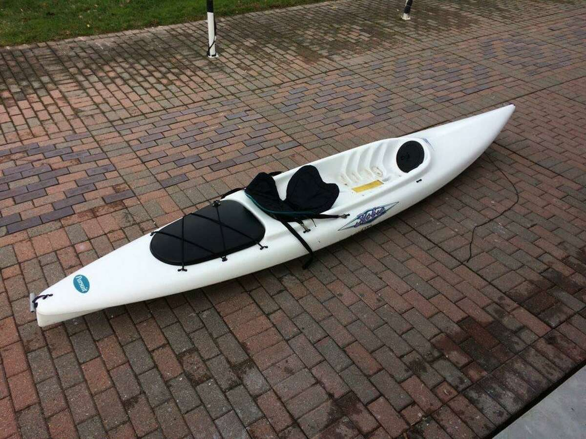 A white kayak was found on the beach in Stamford, Conn., on Nov. 23, 2020.