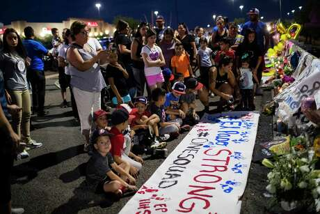 Xsquad and the Hit Squad baseball teams prepared a banner with their handprints honoring the victims of the El Paso shooting Wednesday, Aug. 7, 2019, in El Paso. Xsquad's coach Memo Garcia was shot and has been undergoing surgeries. His wife Jessica Coca Garcia was also shot and has been released from the hospital.
