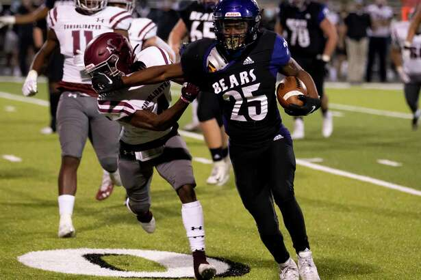 In this file photo, Montgomery running back Adavion Johnson (25) pushes off A&M Consolidated player Jaylon Walter (4) during the second quarter of a District 10-5A (Div. II) football game at Montgomery ISD Stadium on Friday, Nov. 13, 2020.
