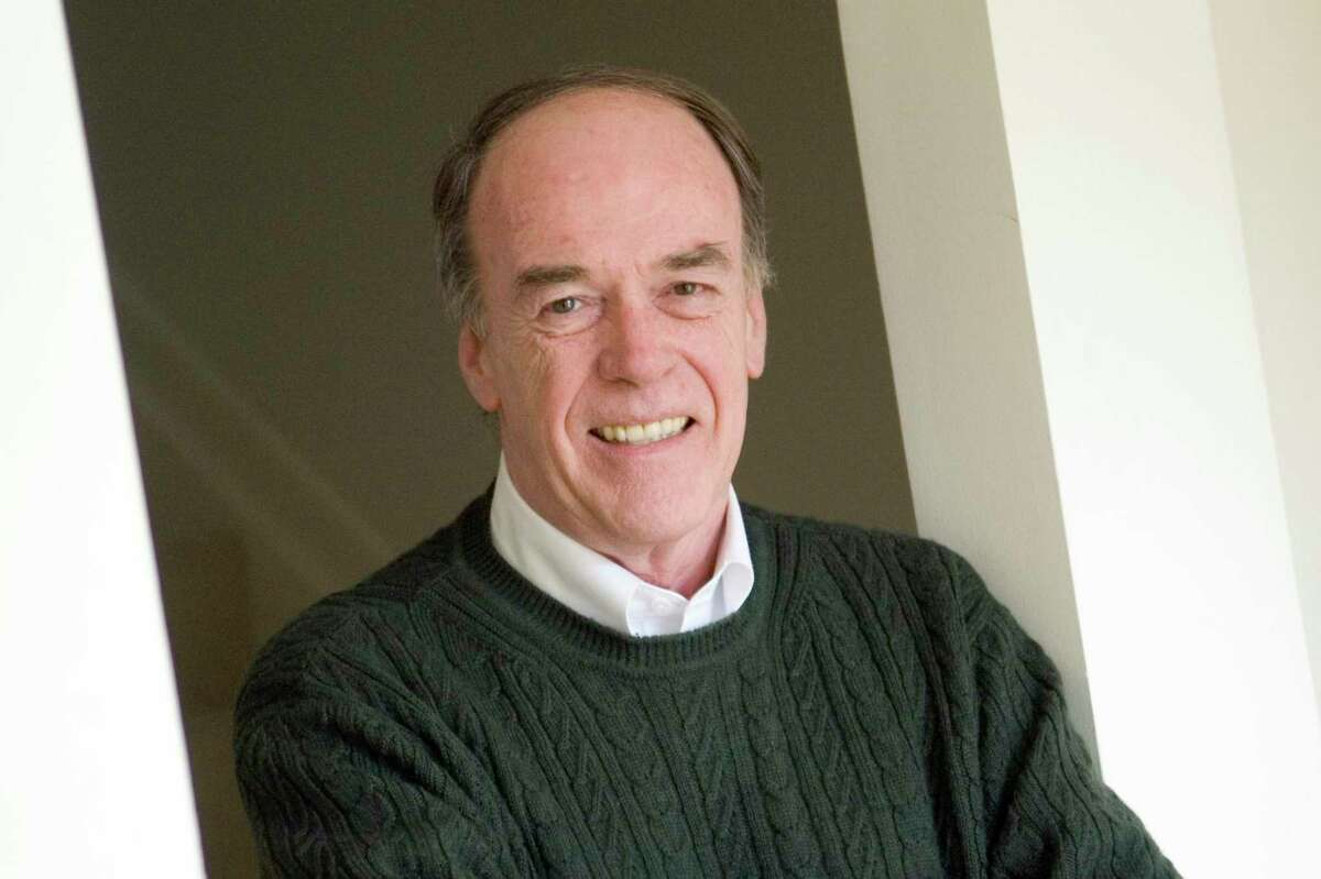 Bob Kennedy, former sports editor of The Advocate poses at home on Tuesday, March 11, 2008.