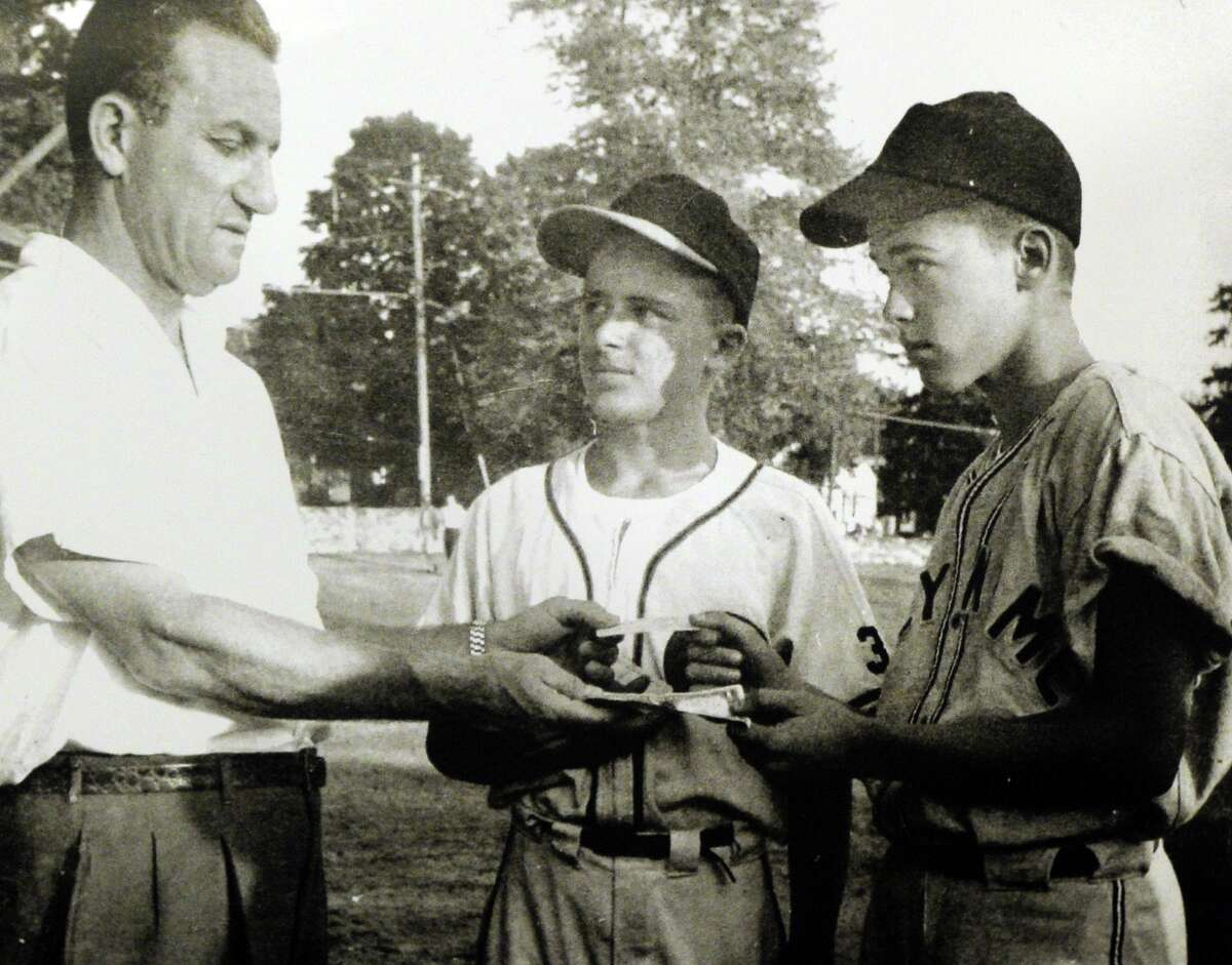 Former Stamford Advocate sports editor Bob Kennedy, right, as a 14-year-old Stamford Babe Ruth baseball player for the Holy Name team with Babe Vozzella, center, and John Scalzi (who played major league baseball for the Boston Braves and is the namesake of Scalzi Park in Stamford).