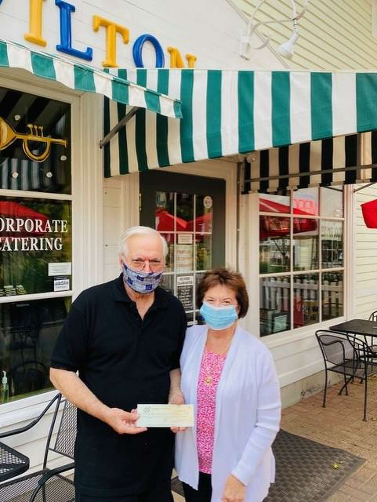 Alfredo LoPresti, manager of Wilton Pizza, presents a check for $150 to Sally Maraventano Kirmser, president of Stay at Home in Wilton after a pizza night where 15 percent of the proceeds of orders benefited the charity.