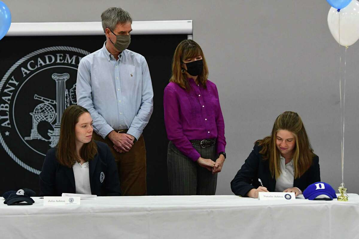 Albany Academy rower Natalie Ashton signs a letter of intent for Duke University during a college signing ceremony at Albany Academy on Monday, Nov. 23, 2020 in Albany, N.Y. Natalie's sister Julia, who was signing to row at Georgetown, sits next to her at left. (Lori Van Buren/Times Union)