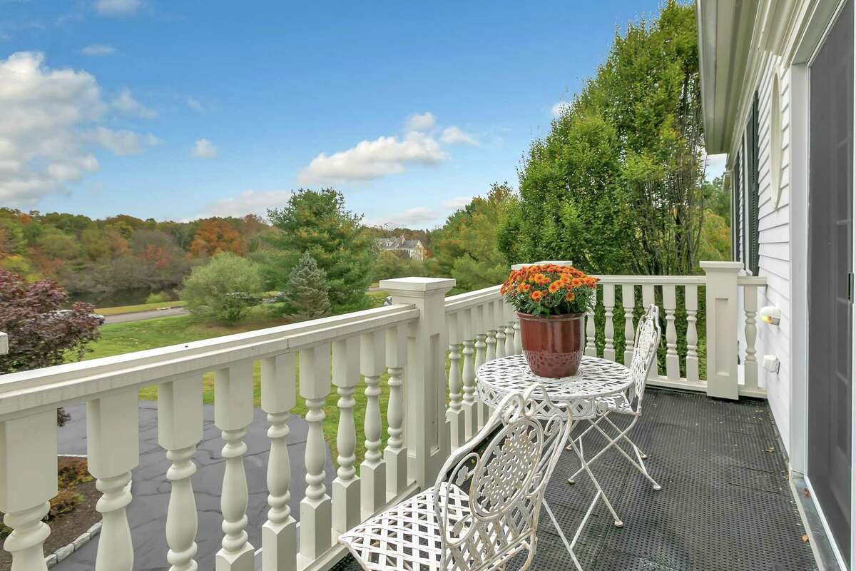 On the second floor landing there are sliding doors to a balcony that looks over the attractive and quiet cul-de-sac.