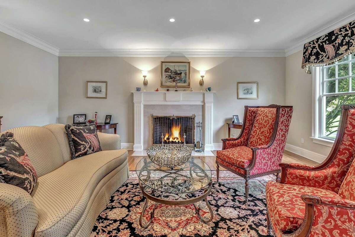 The formal living room, which features a marble fireplace, was featured in a film called The Sacrificial Lamb. Bucari also appreciated the home's interior, citing its
