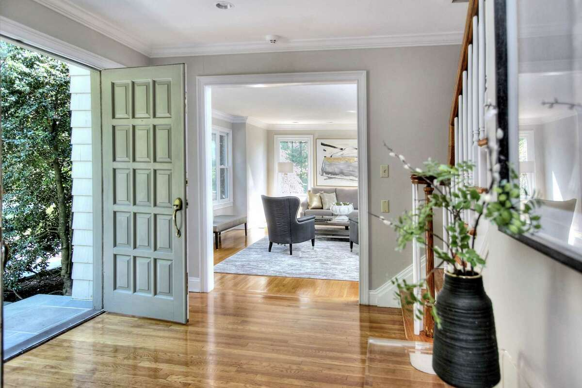 French doors (only one pictured), flanked by tall sidelights, open into the foyer, revealing 4,284 square feet of living space.
