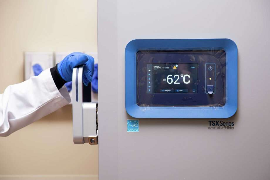 Ahmed El Kority, pharmacy director at Riverside Shore Memorial Hospital in Virginia, inspects a new ultracold freezer that will be used to store coronavirus vaccine that must be kept as cold as minus-70 Celsius. Photo: Photo For The Washington Post By Parker Michels-Boyce / Parker Michels-Boyce