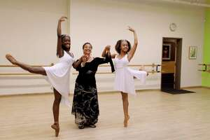 """Debbie Allen, center, with students Destiny Wimpye and Jalyn Flowers in a scene from """"Dance Dreams: Hot Chocolate Nutcracker"""