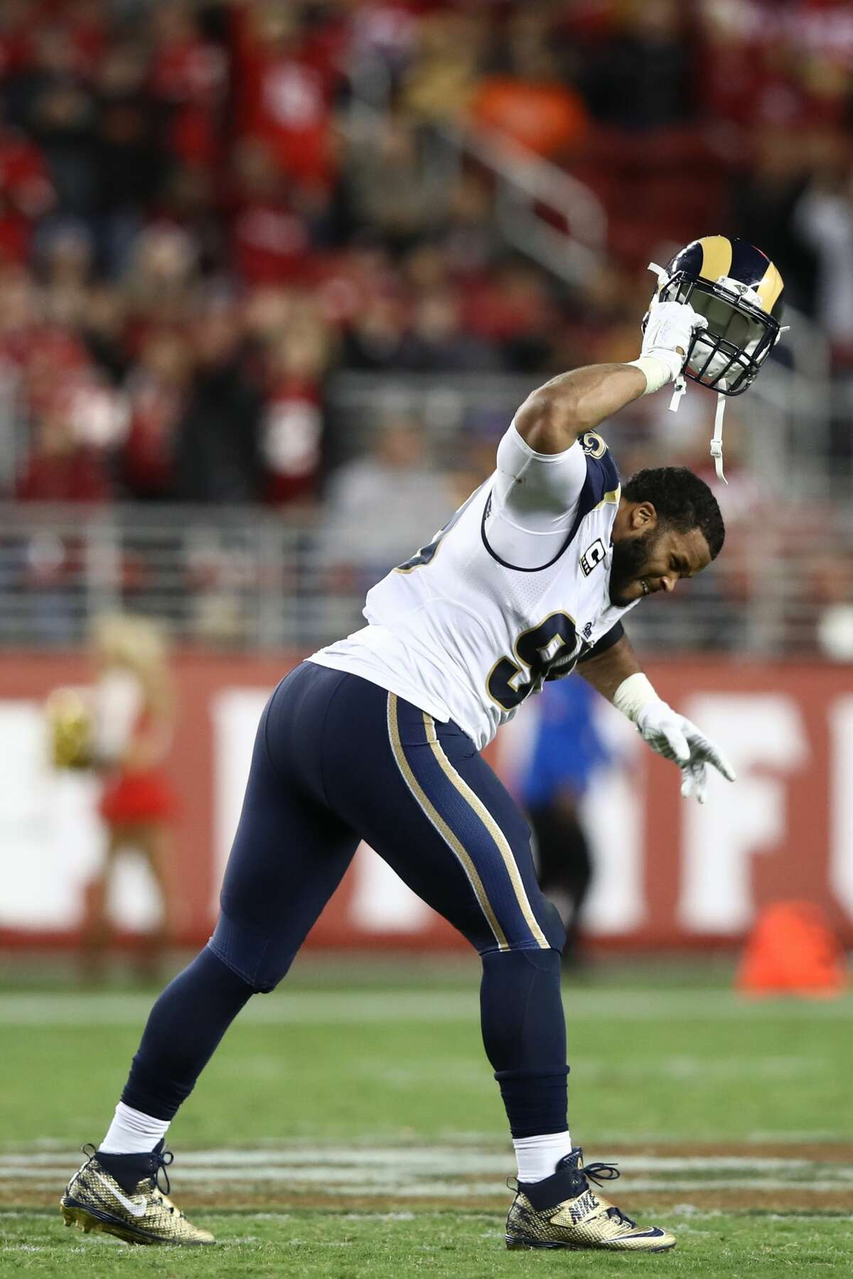 Aaron Donald of the Los Angeles Rams slams his helmet to the turf after being ejected for contact with an official during the NFL game against the San Francisco 49ers at Levi's Stadium on Sept. 12, 2016, in Santa Clara, Calif.
