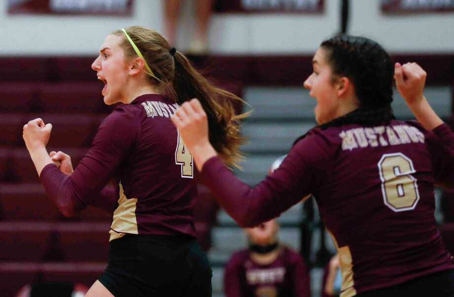 In this file photo, Magnolia West setter Bethany May (4) reacts after a point beside outside hitter Danielle Wysocki (6). The Mustangs advanced to the third round of the postseason with their win Monday, Nov. 23. Photo: Jason Fochtman, Houston Chronicle / Staff Photographer / 2020 © Houston Chronicle