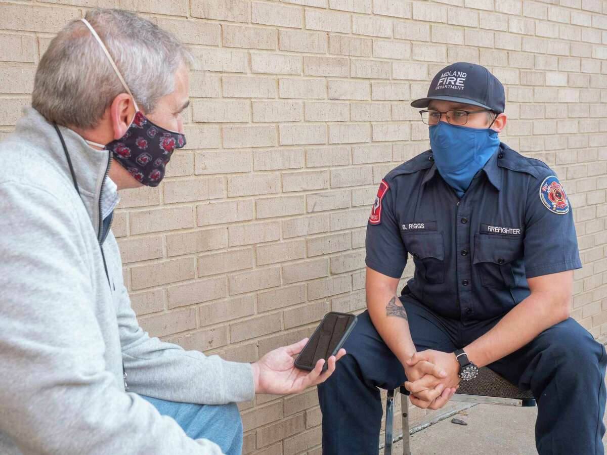 MRT's Stewart Doreen talks with Midland firefighter/paramedic Brantly Riggs 11/23/2020 about responding to the call last year when Doreen had a cardiac emergency. Tim Fischer/Reporter-Telegram