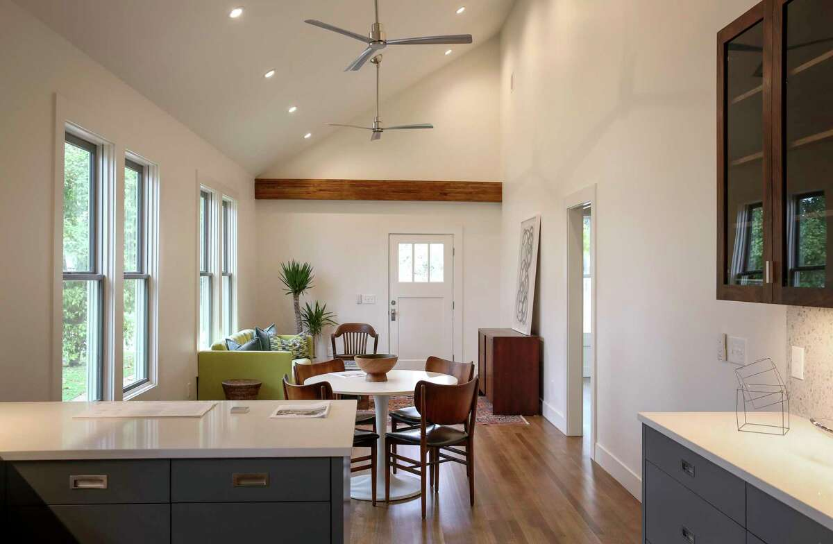 An interior photo of the renovated and restored home at 1508 Ovid. The home's interior once had walls that created several small rooms. Now the main living area is open and has a vaulted ceiling.