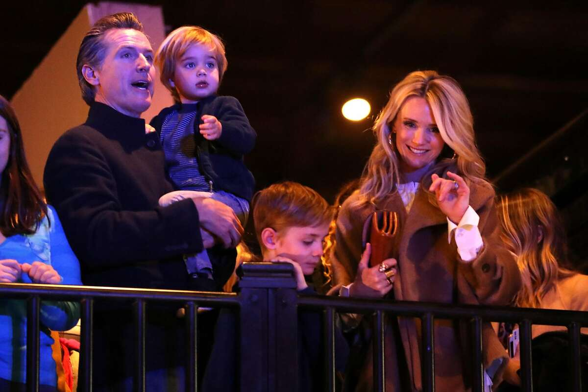 California Governor-Elect Gavin Newsom holds his son, Dutch, 2, next to his wife, Jennifer Siebel Newsom, and his other son, Hunter, 7, during Inauguration Family Event at California Railroad Museum in Sacramento, Calif. on Sunday, January 6, 2019.