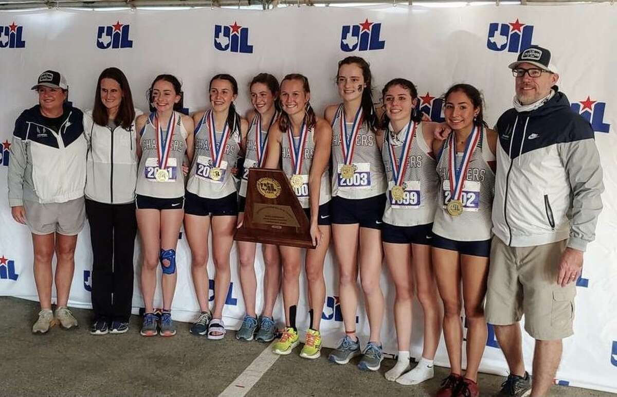 Members of Boerne Champion pose with the Class 5A state championship trophy they won on Monday, Nov. 23, 2020 at Old Settlers Park in Round Rock.