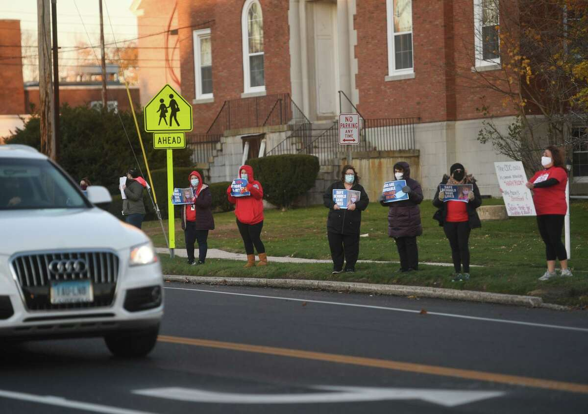 Maintaining that the district isn't responding to rising numbers of COVID-19 cases, Stratford teachers protest on Main Street in Stratford in November.