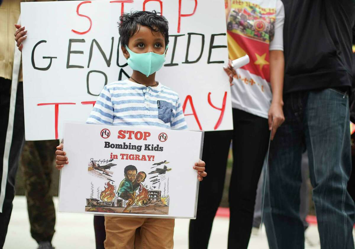 Yohannes Kidane, 5, holds a sign at a rally in support of Ethoipia's Tigray region in Houston on Monday, Nov. 23, 2020.
