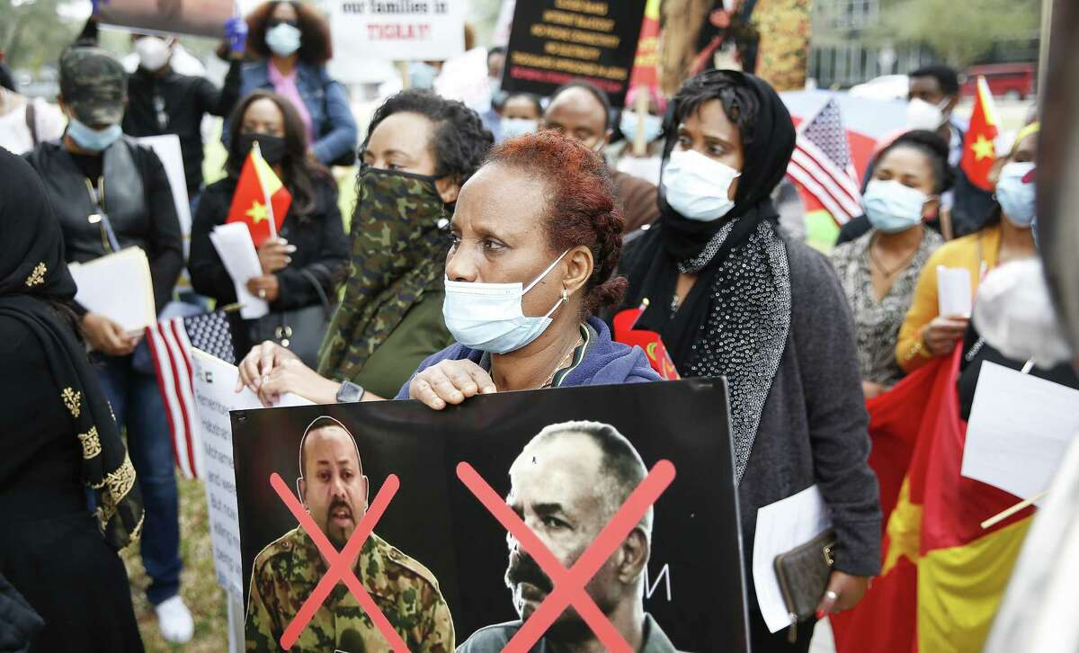 Houstonians, some from Ethoipia's Tigray region, hold a rally protesting the UAE's involvement in the fighting outside the UAE's Consulate office in Houston on Monday, Nov. 23, 2020.