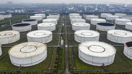 Oil storage tanks are seen in this aerial photograph taken on the outskirts of Ningbo, Zhejiang Province, China, on April 22, 2020. MUST CREDIT: Bloomberg photo by Qilai Shen