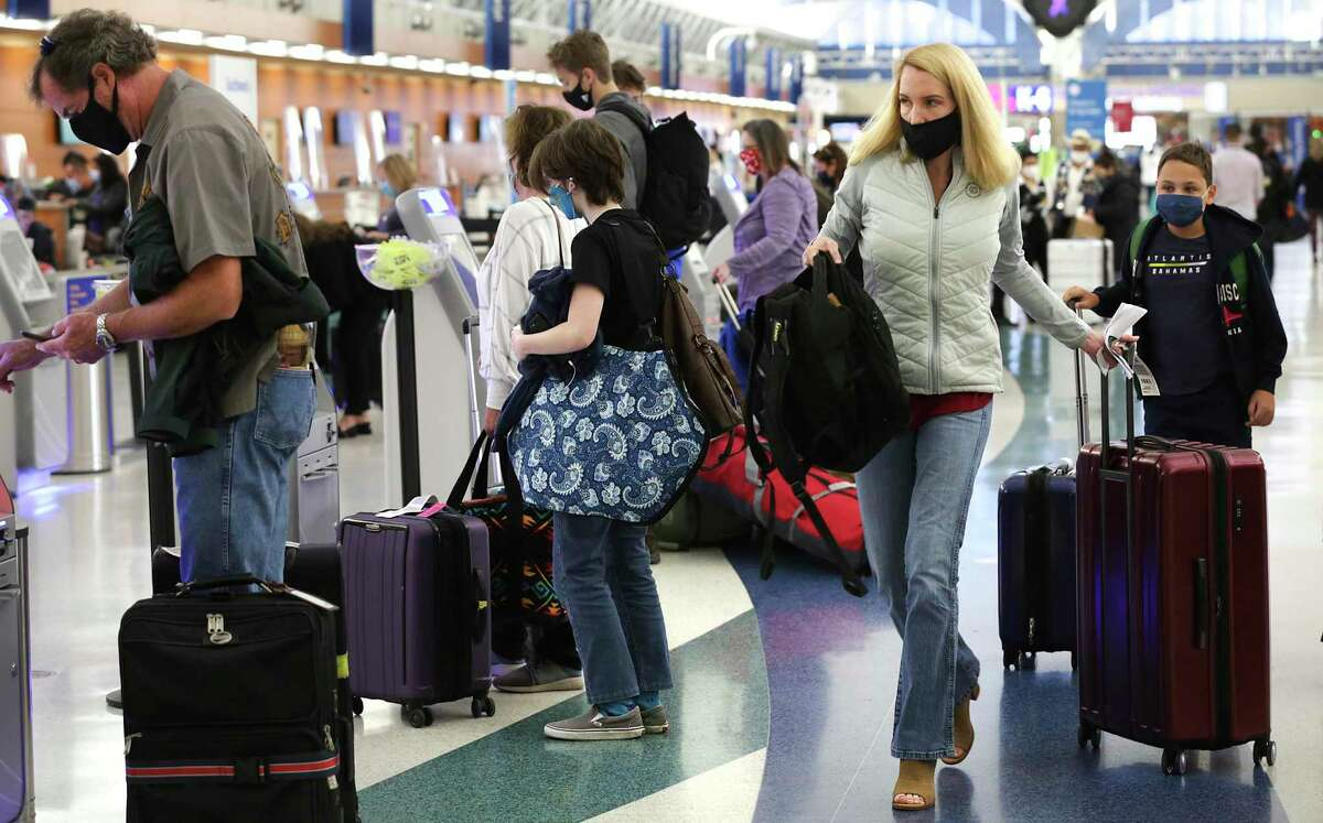 Travelers make their way to check in at the San Antonio airport Monday. Thanksgiving is traditionally one of the year's busiest travel times.