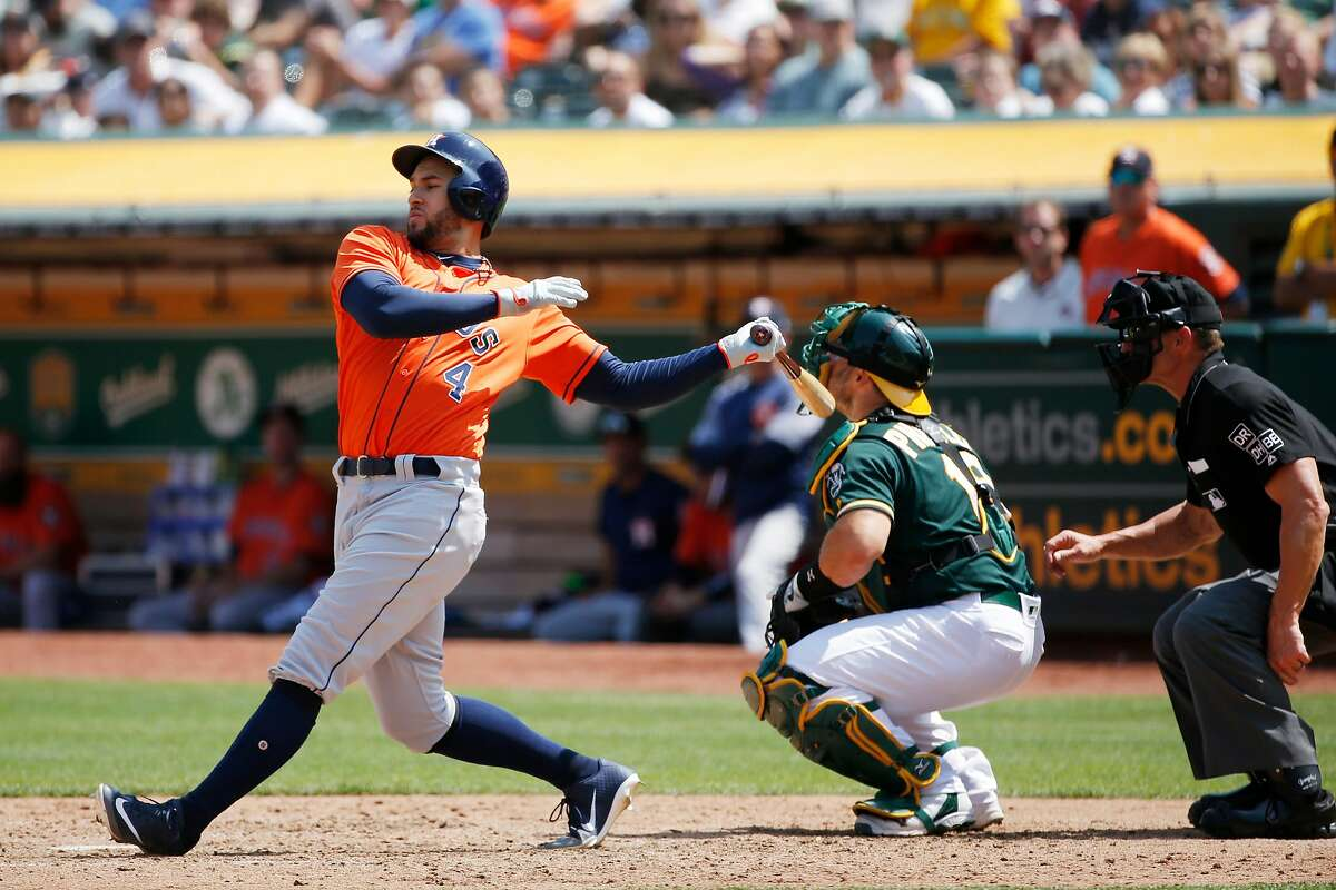 Houston Astros center fielder George Springer (4) swings and misses against Oakland Athletics starting pitcher Trevor Cahill (53) during an MLB game between the Oakland Athletics and Houston Astros at the OaklandÐAlameda County Coliseum on Saturday, Aug. 18, 2018, in Oakland, Calif.