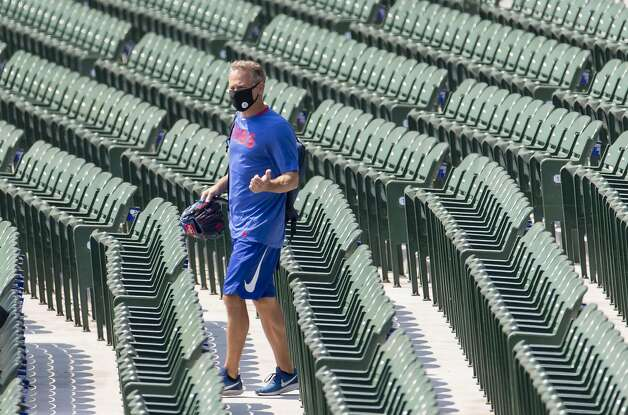 Chicago Cubs General Manager Jed Hoyer, with his glove, walks out to the field for a workout at Wrigley Field on July 6, 2020. (Brian Cassella/Chicago Tribune/TNS) Photo: Brian Cassella, TNS