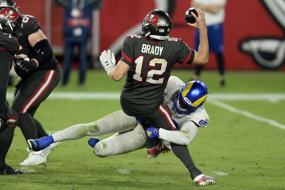 Los Angeles Rams outside linebacker Samson Ebukam sacks Tampa Bay Buccaneers quarterback Tom Brady during the second half of a Nov. 23 game.