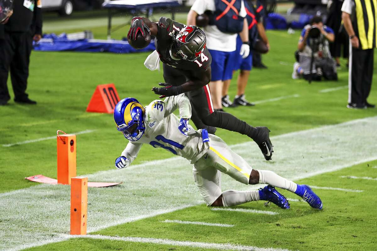Tampa Bay Buccaneers wide receiver Chris Godwin leaps over Los Angeles Rams defensive back Darious Williams to score a touchdown and tie the game in the fourth quarter.