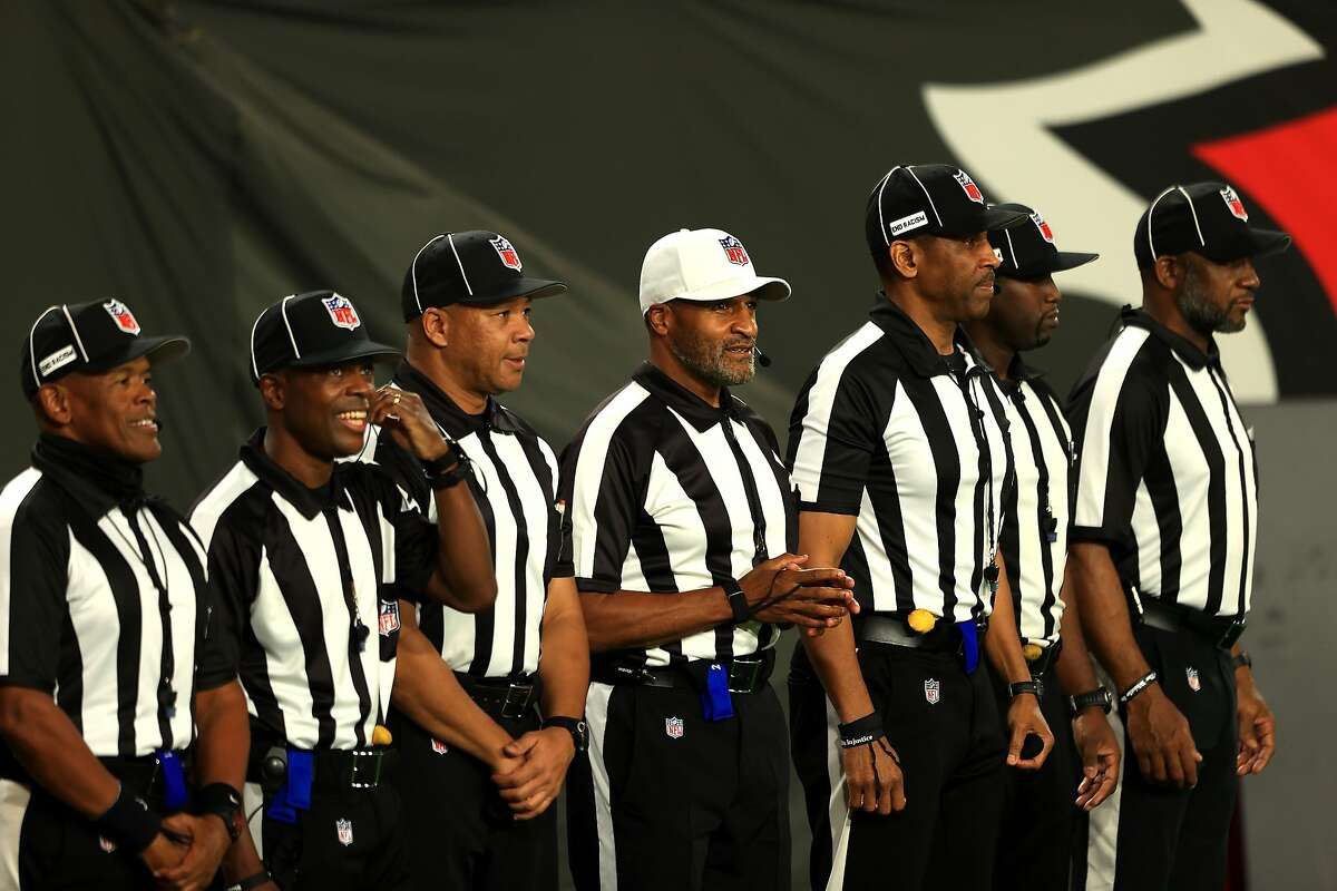 The first all-Black officiating crew works tonight's football game between the Tampa Bay Buccaneers and the Los Angeles Rams at Raymond James Stadium on November 23, 2020 in Tampa, Florida.