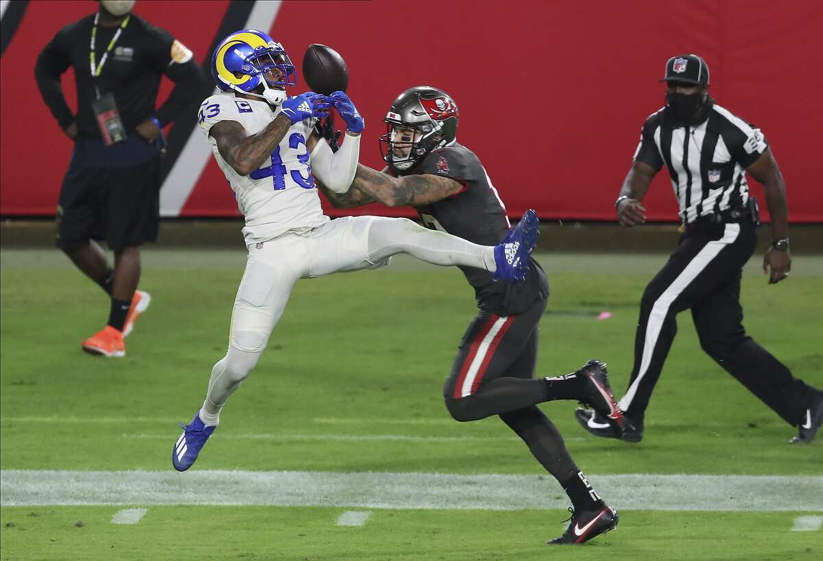Los Angeles Rams free safety John Johnson (43) breaks up a pass intended for Tampa Bay Buccaneers wide receiver Mike Evans (13) during the first half of an NFL football game Monday, Nov. 23, 2020, in Tampa, Fla.