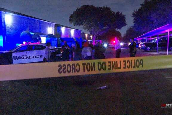 Police investigate the shooting deaths of a man and a woman in west Houston on Monday, Nov. 23, 2020.