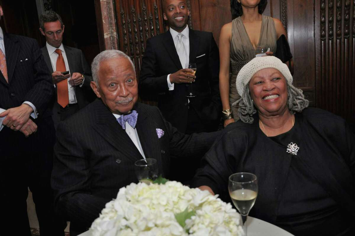 Former New York Mayor David Dinkins and author Toni Morrison, seated, at a gala honoring the centennial of the New York Public Library's flagship building at 42nd Street and Fifth Avenue on May 23, 2011.